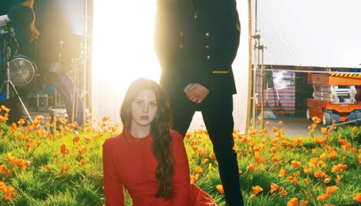"Lana Del Rey & The Weeknd Dance Upon Hollywood Sign in Romantic ""Lust For Life"" Video"